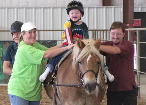 hippotherapy certification client laughing on horse